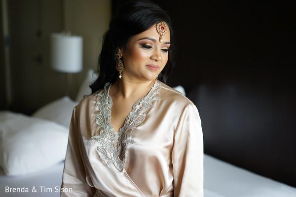 Dazzling indian bride with her ceremony makeup.
