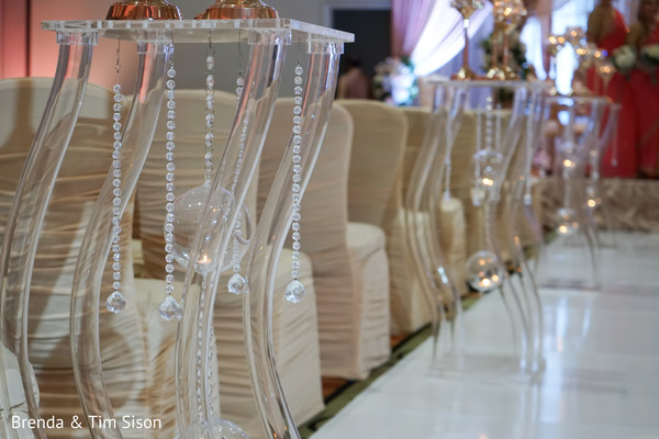 Elegant Indian wedding ceremony aisle crystals decorations.