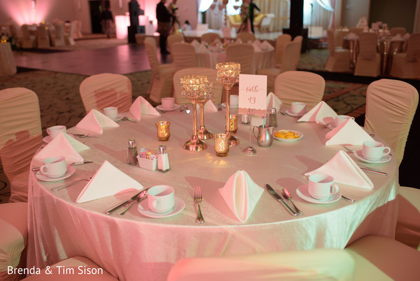 Elegant Indian wedding reception table setup.