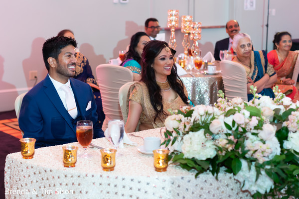 Adorable Indian bride and groom at reception.