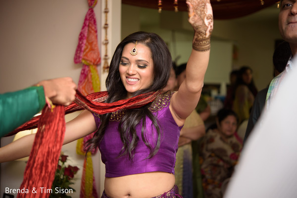 Gorgeous indian bride dancing at her mehendi party.