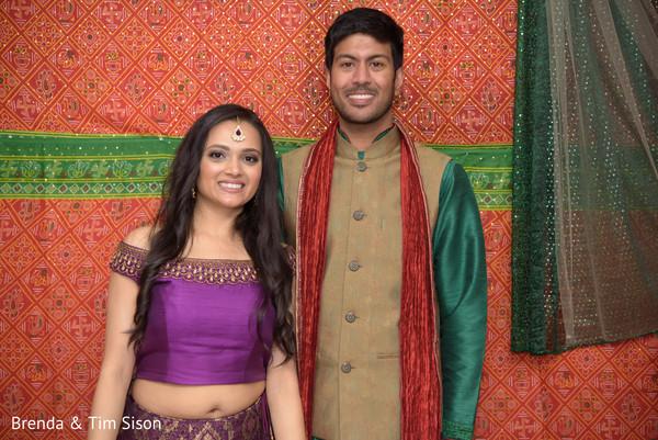 indian couple posing during  pre-wedding celebration.