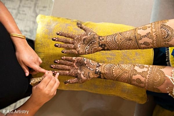 Bride during the mehndi design