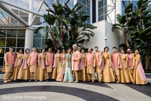 Joyful indian bride and groom with bridesmaids and groomsmen photo.