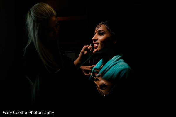 Lovely Indian bride getting her lipstick on.