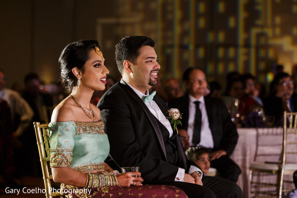 Cheerful Indian bride and groom photo.