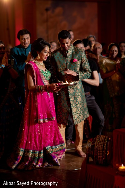 Indian couple at sangeet ritual.