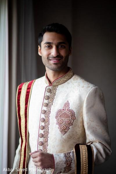 Enhancing groom ready for wedding ceremony.