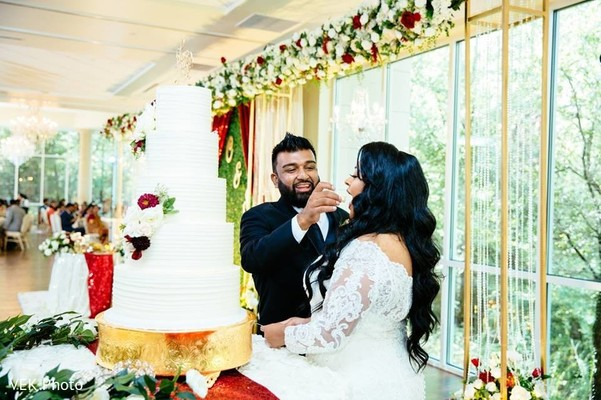 Lovely capture Indian groom giving cake to the bride