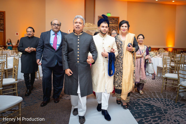 Indian groom making his entrance with family