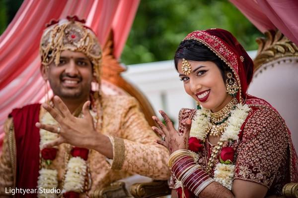 Indian lovebirds showing wedding rings