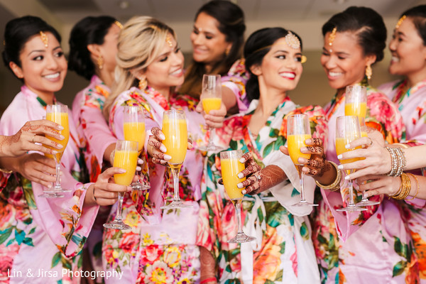 Cheers for Indian bride with bridesmaids.