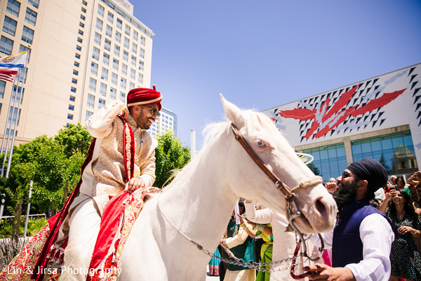 Enchanting Indian groom on his white baraat horse.