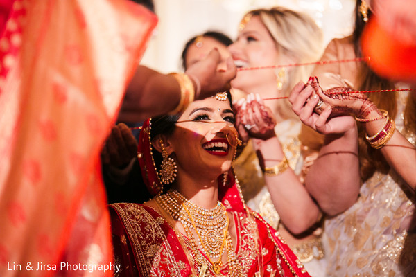 Indian bride getting the lazo at ceremony.