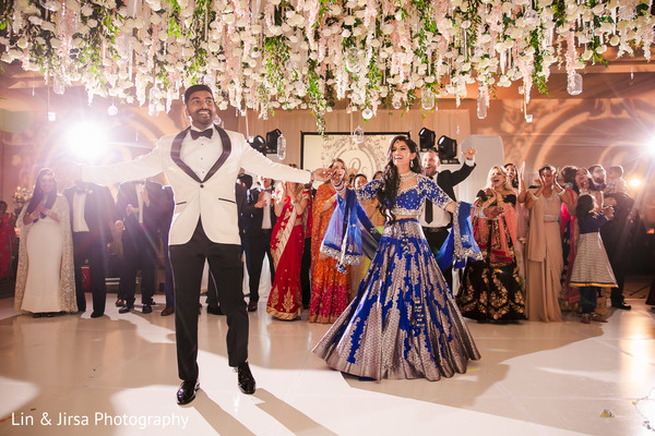 Sweet indian couple at their wedding reception dance.