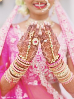Indian bride showing her mehndi and jewelry