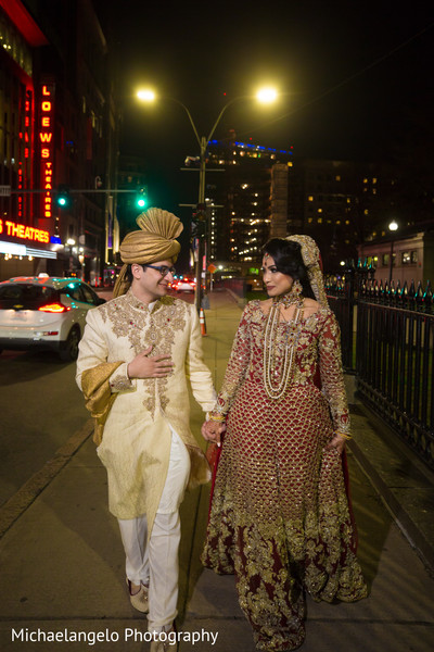 Adorable Indian couple walking holding hands