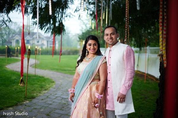 Adorable Indian lovebirds outdoor portrait.