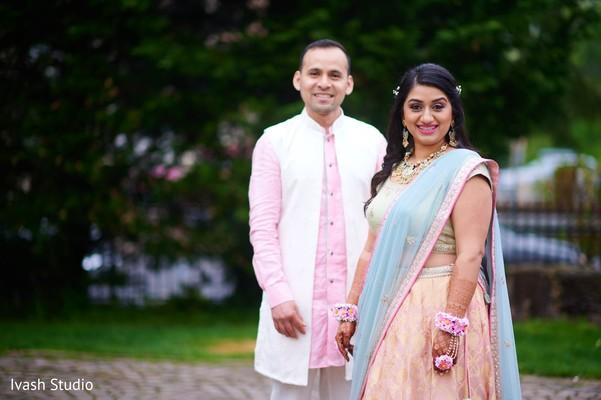 Ravishing indian couple at their mehndi party.