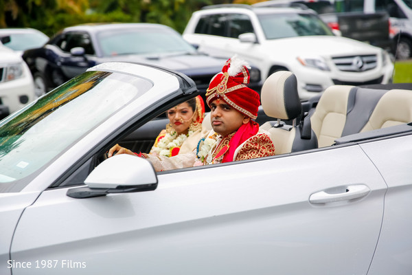 Couple in their ride as they leave the ceremony
