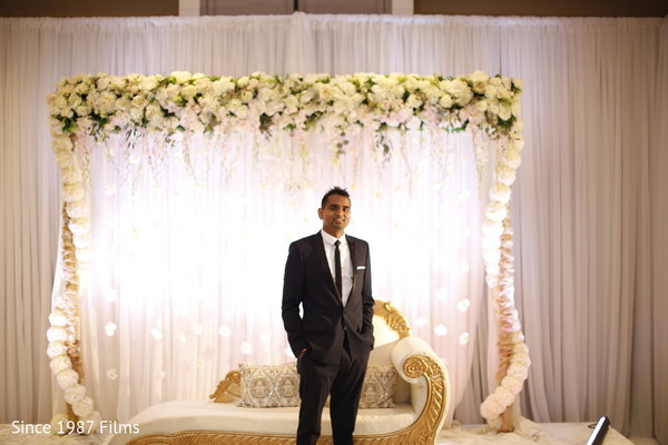 Indian groom posing for pictures