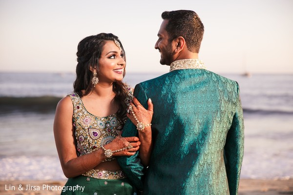 Indian bride and groom looking at each other