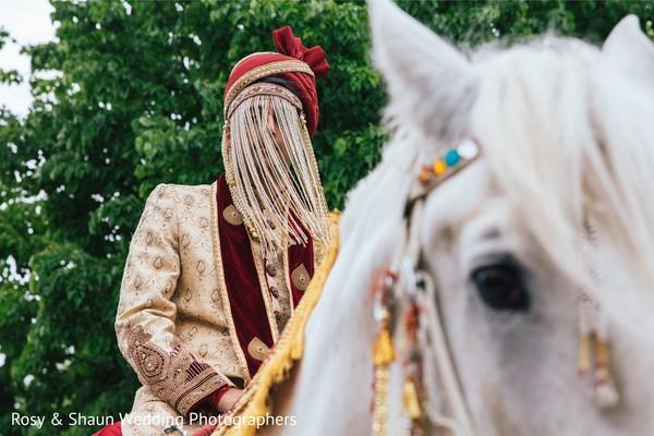Indian groom riding a baraat horse.