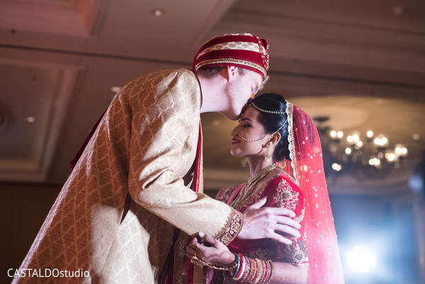 Indian bride and groom kissing