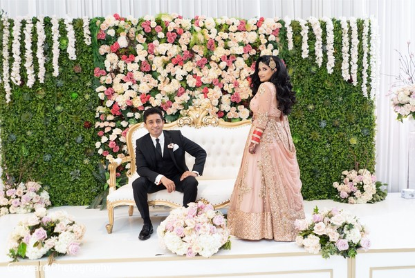 Perfect Indian bride and groom on stage photo session.