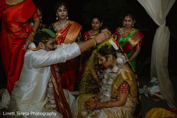 Indian wedding ceremony showering of rice.