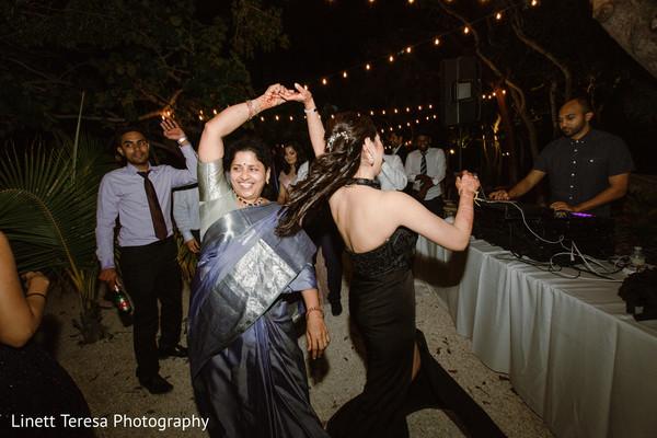 Joyful indian wedding guests dancing
