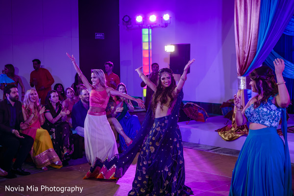 Indian bride and bridesmaids dancing with their sangeet outfits