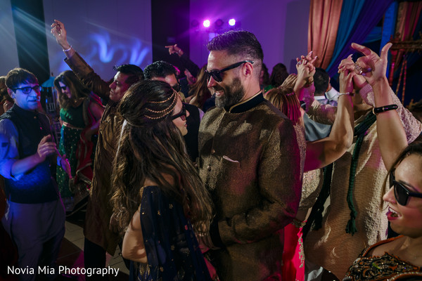 Joyful Indian bride and groom at their sangeet celebration