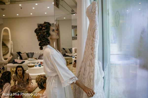Lovely bride looking her wedding dress