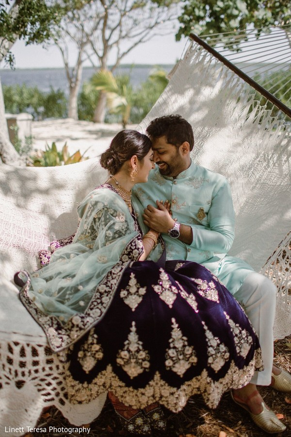 Sweet Indian couple posing outdoors.