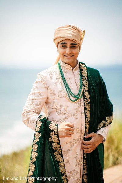 Elegant Indian groom posing for photo shoot.