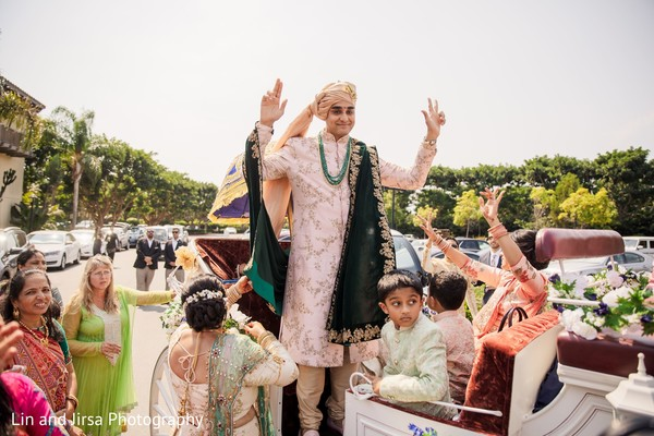 Charming Indian groom on his wedding carriage.