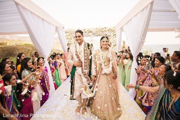 Emotional indian couple walking down the aisle.