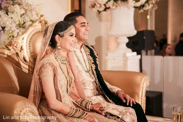 Sweet indian couple enjoying their wedding reception.