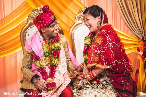 Joyful Indian couple at wedding ceremony.