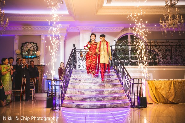 Indian newlyweds making their entrance to wedding reception