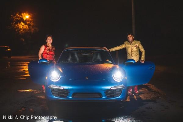 Sweet couple next to their wedding car.