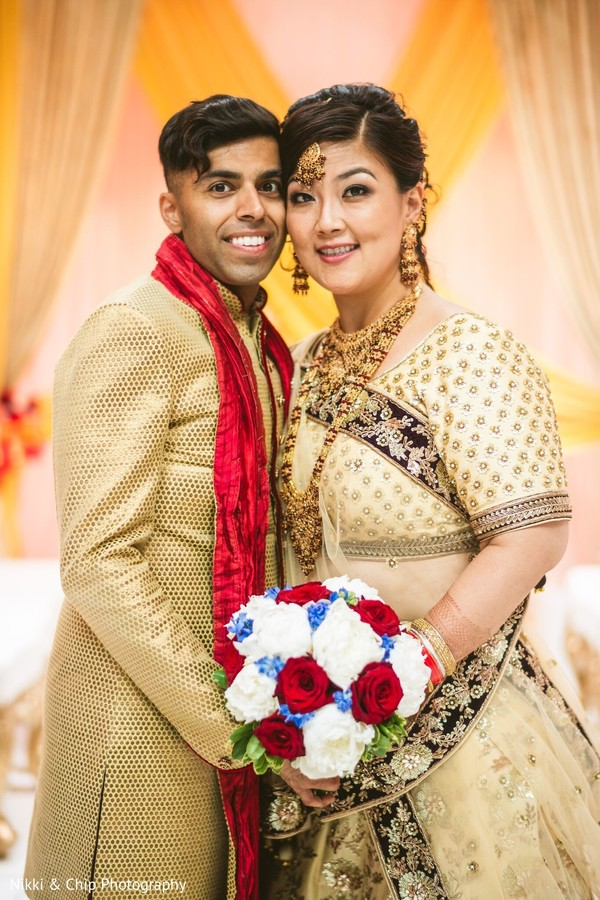 Lovely Indian bride and groom posing for ceremony photo.