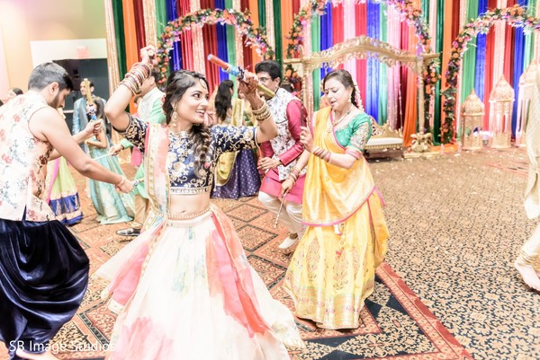 Adorable indian bride during dandia raas dance.