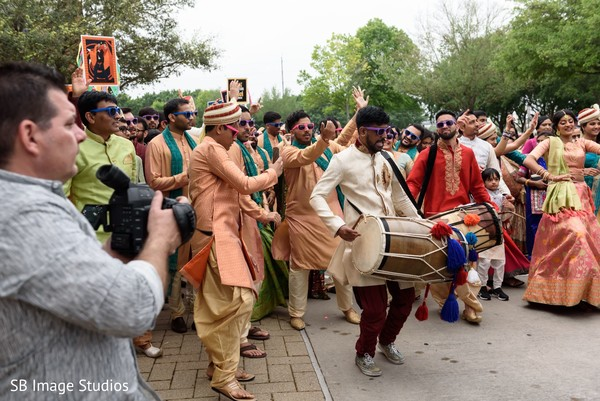 Dhol players during baraat capture.