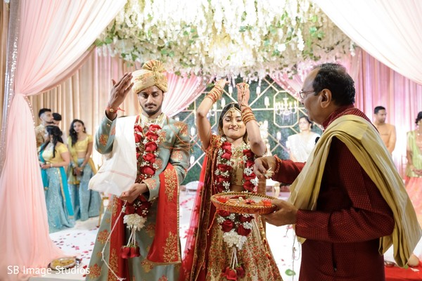 Indian couple during petals ceremony ritual.