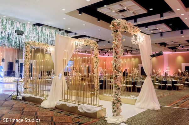 Marvelous indian wedding reception flowers and lights decor.