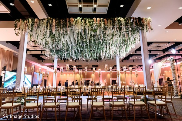 Incredible Indian wedding reception stage flowers decor.
