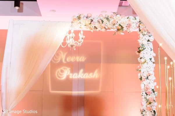 Dreamy Indian wedding reception lights and flowers decor.