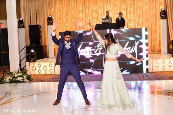 Adorable indian couple showing some dance moves